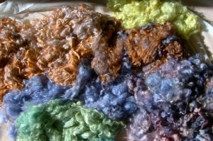 Rainbow dyed wool heaps