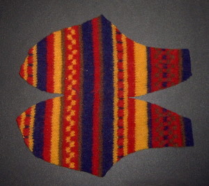 Cut out slipper shape from felted sweater